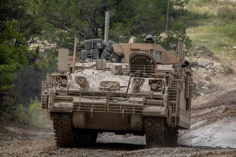 Soldiers from 1st Cavalry Division drive through a low-water crossing in the Armored Multi-Purpose Vehicle (AMPV) after completing field testing on Fort Hood, Texas. ( Maj. Carson Petry/Army)