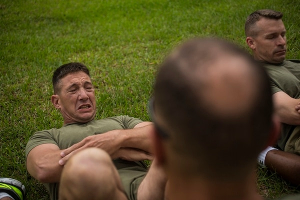 U.S. Marines conduct the crunches portion of a physical fitness test on Marine Corps Air Station Cherry Point, North Carolina, May 21, 2015. (Lance Cpl. Jodson B. Graves/Marine Corps)