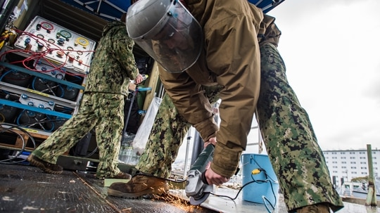 U.S. Navy Builder 2nd Class Sean McHugh, assigned to Underwater Construction Team (UCT) 2, repairs a ladder prior to an underwater pile removal operation at Commander, Fleet Activities Sasebo (CFAS), Jan. 10, 2018. (U.S. Navy Combat Camera photo by Arthurgwain L. Marquez)