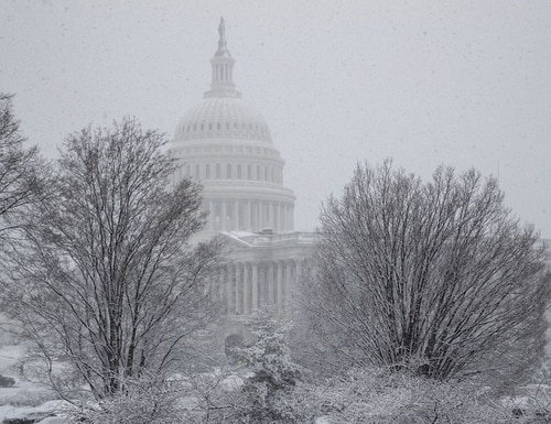 Potentially dangerous weather conditions in the Washington, D.C. area have caused the Office of Personnel Management to order the closure of federal offices to all but emergency personnel. (AP Photo/J. Scott Applewhite)