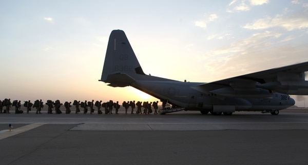 Marines and sailors load onto a KC-130 aircraft on the Camp Bastion, Afghanistan, flightline, in 2014. (Staff Sgt. John Jackson/, Defense Department via AP)