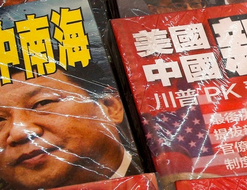 On July 4, magazines with front covers featuring Chinese President Xi Jinping with South China Sea and Xi against U.S. President Donald Trump are placed on sale at a roadside stand in Hong Kong. (Andy Wong/AP)