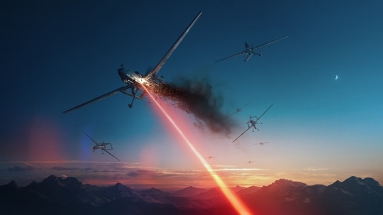 Concept art from Lockheed Martin shows the potential for directed energy weapons against unmanned systems, but its use against missiles may take years still. (Lockheed Martin)