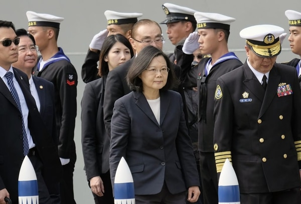 Taiwan President Tsai Ing-wen, center, arrives at the Tsoying navy base in Kaohsiung, southern Taiwan, on March 21, 2017. Taiwan formally launched a project to build its own submarines as the island faces growing military threats from China as relations deteriorate. (Sam Yeh/AFP via Getty Images)