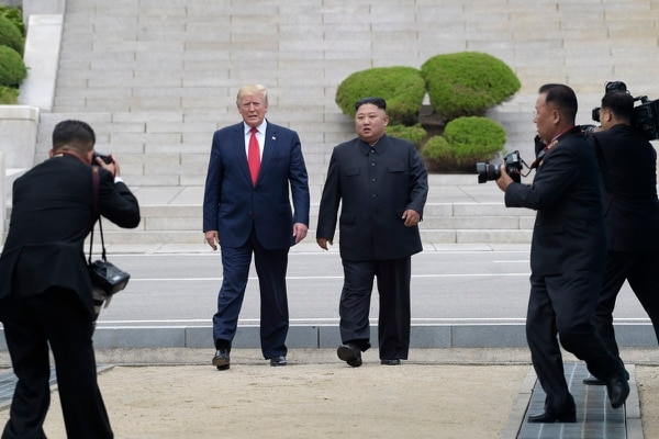 In this June 30, 2019, file photo, President Donald Trump, center left, and North Korean leader Kim Jong Un walk on the North Korean side at the border village of Panmunjom in the Demilitarized Zone. (Susan Walsh/AP)