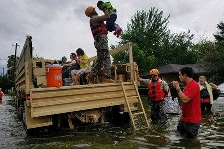 Texas National Guard soldiers arrive in Houston, Texas, to aid citizens in heavily flooded areas from the storms of Hurricane Harvey. (Lt. Zachary West/Army)