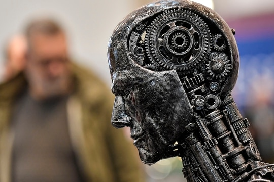 In this Nov. 29, 2019, photo, a metal head made of motor parts symbolizes artificial intelligence, or AI, at the Essen Motor Show for tuning and motorsports in Essen, Germany. The Trump administration is proposing new rules guiding how the U.S. government regulates the use of artificial intelligence in medicine, transportation and other industries. The White House unveiled the proposals Tuesday, Jan. 7, and said they're meant to promote private sector applications of AI that are safe and fair. (Martin Meissner/AP)