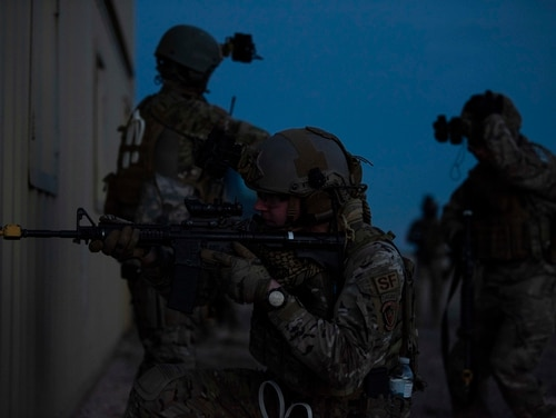 Airmen from the 27th Special Operations Security Forces Squadron check around a building for enemies during a mass casualty exercise at Cannon Air Force Base, N.M., Jan. 14. (Airman 1st Class Gage Daniel/Air Force)