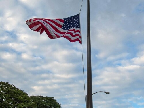 PEARL HARBOR (July 21, 2015) The American flag is flown at half-mast at Joint Base Pearl Harbor-Hickam, July 21, 2015. The flag will remain at half-mast through July 25 to honor each service member killed by a gunman in Chattanooga, Tenn. U.S. Navy photo by Mass Communication Specialist 1st Class Meranda Keller (Released)