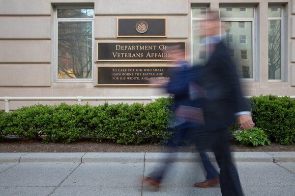 Exterior photos of people walking by the Department of Veteran Affairs in Washington, DC, on Thursday, April 14, 2016. [SENTENCE 2] (Alan Lessig/Staff)