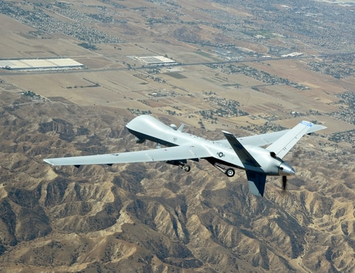 A suspected U.S. drone strike Friday killed seven alleged al-Qaida militants in Yemen, tribal leaders say. Pictured: An MQ-9 Reaper soars over Southern California a training flight to March Air Reserve Base, Calif., on Sept. 15, 2016. (Tech. Sgt. Neil Ballecer/Air National Guard)