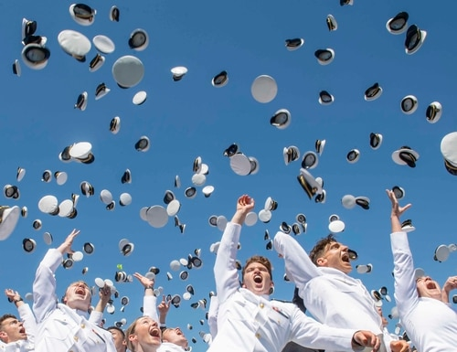 Midshipmen toss their covers in the air during the United States Naval Academy's Class of 2019 graduation and commissioning ceremony on May 24. (Mass Communication Specialist 3rd Class Josiah D. Pearce/Navy)