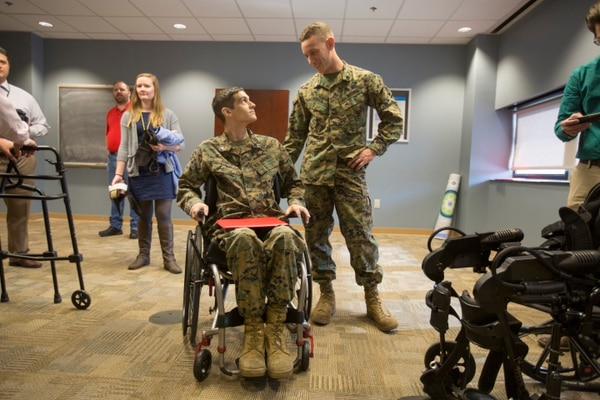 Cpl. Josh Burch talks with his brother Staff Sgt. Travis Burch after Josh's promotion ceremony at Hunter Holmes McGuire VA Medical Center in Richmond, Va., on Friday, February 5, 2016. (Mike Morones/Staff)