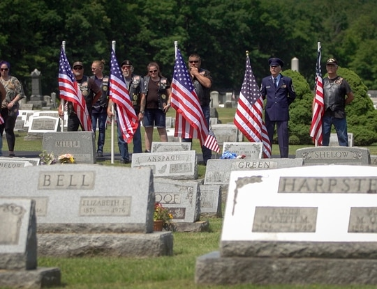 Veterans hold American flags at the funeral for Cpl. Paul Wilkins at Logan Valley Cemetery Saturday, June 16, 2021 in Bellwood, Pa. The Army declared Wilkins missing in action in July 1950 during the Korean War, and his remains were finally discovered 70 years later. Walter was a teenager the last time he saw his brother. (Lauren Schneiderman/The Philadelphia Inquirer via AP)