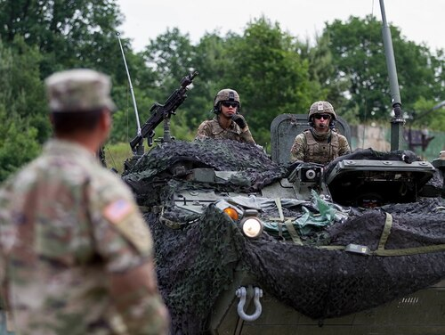 A 2d Cavalry Regiment Stryker crew queues for ammunition distribution during a training event during U.S. Army Europe's exercise Saber Strike 18, Powidz, Poland, June 1, 2018. (Capt. Jeku Arce/Army Reserve)