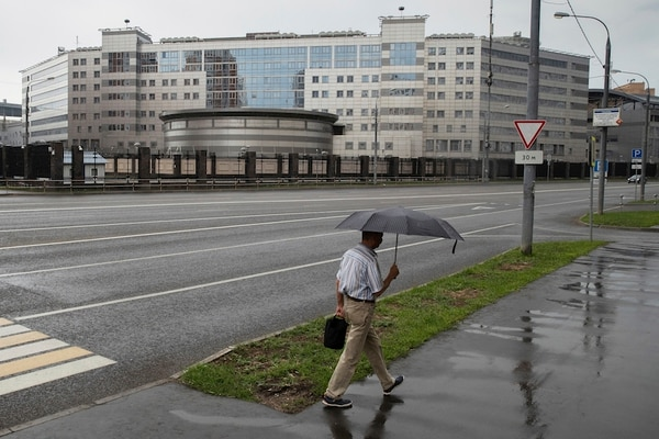 FILE - In this Saturday, July 14, 2018 file photo, a man walks past the building of the Russian military intelligence service in Moscow, Russia. Russia's military intelligence service GRU is attracting increasing attention as allegations mount of devious and deadly operations on and off the field of battle. (AP Photo/Pavel Golovkin, File)
