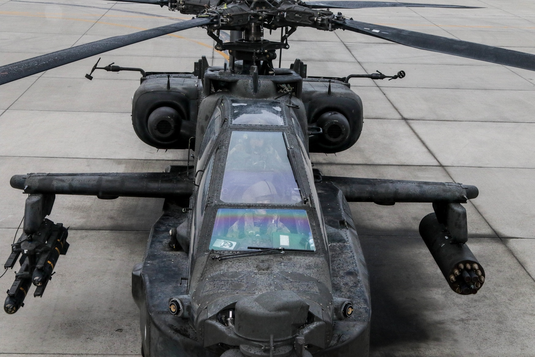 An AH-64 sits ready for take-off as the Apache pilots conduct their final pre-flight inspections inside the aircraft in Afghanistan. (Capt. Roxana Thompson/Army)