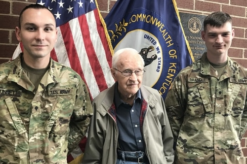 Spc. Justin Stinnett, left, and Spc. Casey Brandle, far right, share a photo op with David Hamilton in Owensboro, Ky., March 19. Stinnett and Brandle are credited with saving Hamilton from an auto accident in flood waters in Owensboro on Feb. 27. (Sgt. Brooklynd Decker/Army)