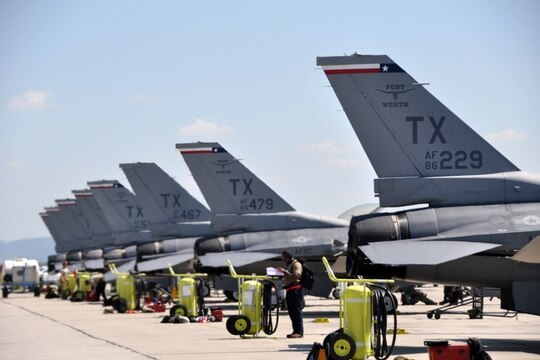 F-16C Fighting Falcons assigned to the 457th Expeditionary Fighter Squadron are parked on the flight line at the 71st Air Base, Campia Turzii, Romania, in June 2019. (Master Sgt. Megan Crusher/Air Force)