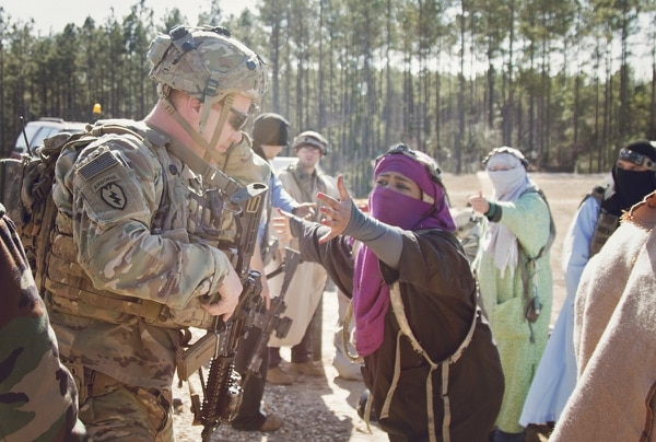Capt. Christopher Young speaks to local Afghan role players during 1st SFAB's Joint Readiness Training Rotation at Fort Polk, La. (Staff Sgt. Sierra Melendez/Army)