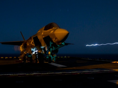 Marines with Marine Fighter Attack Squadron 211, 13th Marine Expeditionary Unit, load ordnance into an F-35B Lightning II aboard the Wasp-class amphibious assault ship Essex (LHD 2) in preparation for the F-35B's first combat strike, Sept. 27. (Cpl. A. J. Van Fredenberg/Marine Corps)