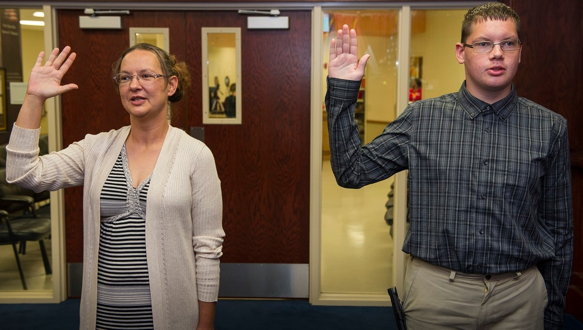 All in the Navy family — mother and son enlist together