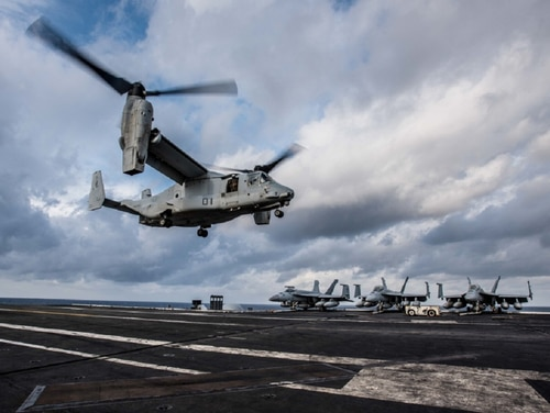 An MV-22 Osprey of Marine Medium Tiltrotor Squadron 265 lands on the flight deck of the aircraft carrier Ronald Reagan. The Navy's transition to replace its C-2A Greyhounds with a variant of the Osprey kicked off Oct. 1. (photo by Mass Communications Specialist 2nd Class Janweb B. Lagazo/Navy)