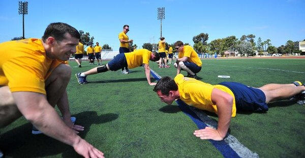 Sailors perform the two-minute push-up test as part of the fiscal 2013 cycle one Physical Fitness Assessment. (Mass Communication Specialist Seaman Christopher Pratt/Navy)