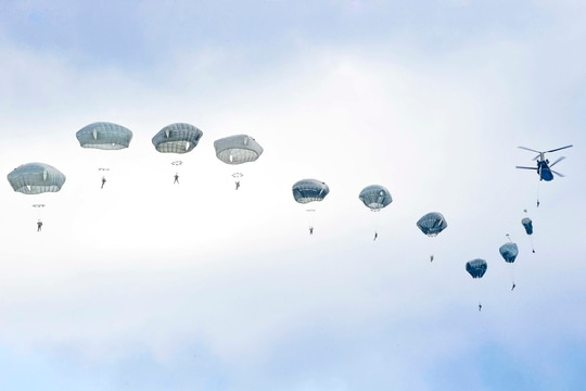 U.S. Army paratroopers execute an airborne proficiency jump from a CH-47 Chinook helicopter onto Bunker Drop Zone in Grafenwoehr Training Area, Germany, Aug. 14, 2019. (Army)