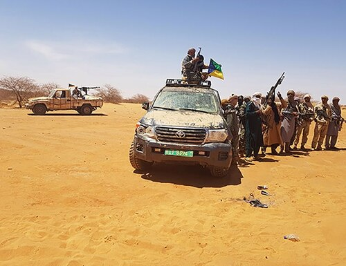 This image taken on on March 17, 2018, in Menaka, Mali, shows Azawad Salvation Movement (ASM) militants flying their flag atop of an off road veichle recovered during an operation conducted by ASM militants and said to have belonged to four American soldiers killed during an ambush in the Tongo Tongo area in West Niger on Oct. 4, 2017. (AFP via Getty Images)