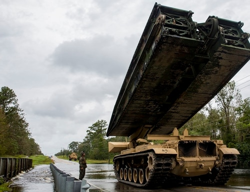 Marines from Mobility Assault Company, 2nd Combat Engineer Battalion, 2nd Marine Division, deploy a armored vehicle launch bridge after Hurricane Florence on Marine Corps Base Camp Lejeune, Sept. 16. (Lance Cpl. Isaiah Gomez/Marine Corps)