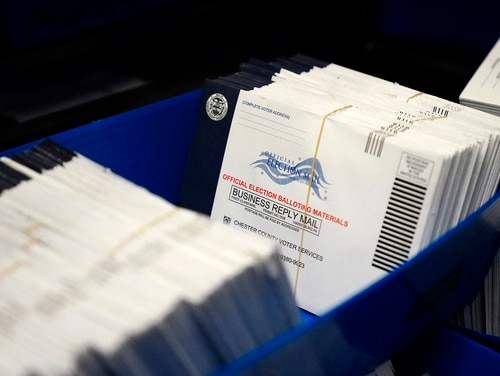 In this Oct. 23, 2020, file photo, mail-in ballots for the 2020 general election in the United States are seen after being sorted at the Chester County Voter Services office, in West Chester, Pa. (Matt Slocum/AP)