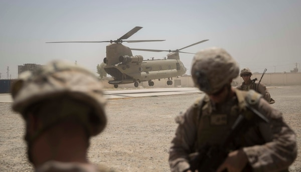 A Ch-47 Chinook lands to transport U.S. Marine advisers with Task Force Southwest after a train, advise and assist mission at the Helmand Provincial Police Headquarters in Lashkar Gah, Afghanistan, July 9, 2017. (Sgt. Justin T. Updegraff/Marine Corps)