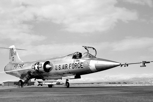 An F-104A with ventrally-mounted Air Launched Sounding Rocket (ALSOR). NASA test pilot Milton O. Thompson ejected from this aircraft on Dec. 20, 1962, after an asymmetrical flap condition made the jet uncontrollable. (NASA Photo)