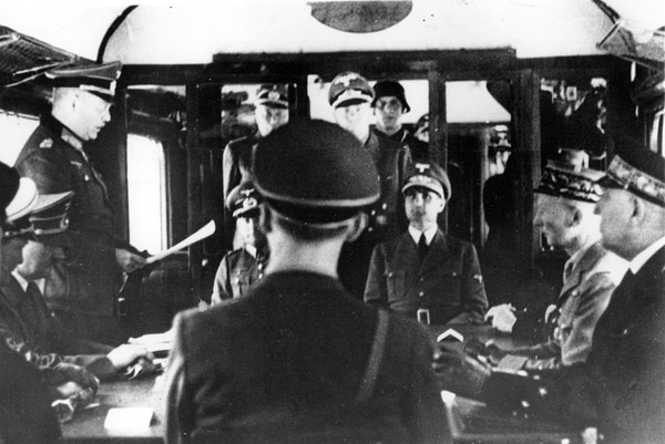 In this June, 21 1940, file photo, representatives of Germany with Adolf Hitler, seated second left, and France meet at Compiegne Forest, France, in the railroad dining car to discuss terms during World War II. (AP Photo)