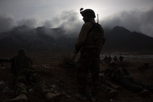 Special operators of the Afghan National Mission Brigade prepare for a nighttime, live-fire training exercise at a training complex near Kabul, Afghanistan, Feb. 12. The Afghan Special Security Forces often operate at night in complex urban areas and arduous mountain terrain. (Spc. Austin T. Boucher/Army)