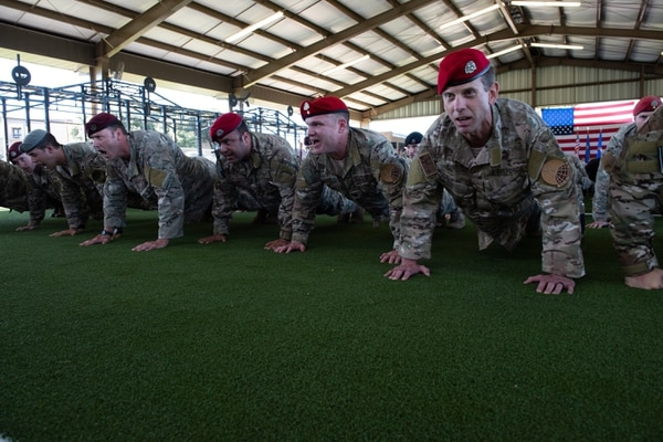 Special Warfare Training Wing members honor the fallen with memorial pushups after the activation ceremony at Joint Base San Antonio-Medina Base, Texas, Oct. 10. (Andrew Patterson/Air Force)