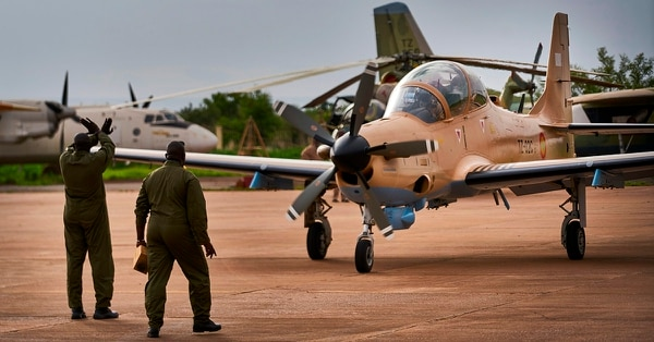 A new A-29 Super Tucano lands for a presentation ceremony at the military base in Bamako, Mali, on July 11. (Michelle Cattani/AFP/Getty Images)