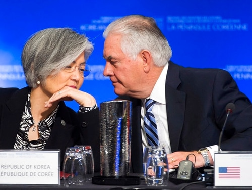 U.S. Secretary of State Rex Tillerson speaks with South Korean Foreign Minister Kang Kyung-wha during a meeting on North Korea in Vancouver, British Columbia, Tuesday, Jan. 16, 2018. Officials are discussing sanctions, preventing the spread of weapons and diplomatic options. (Jonathan Hayward/The Canadian Press via AP)