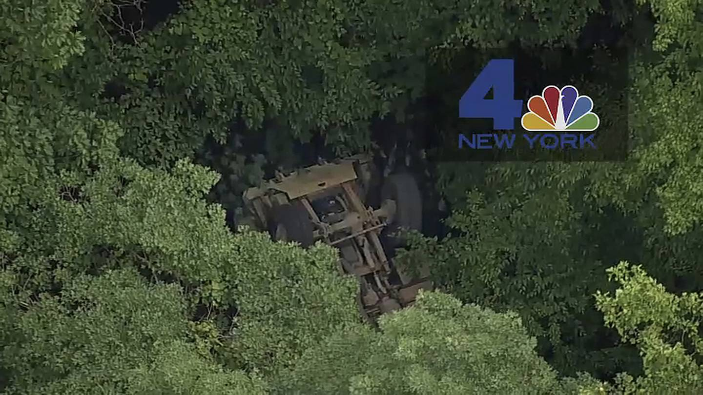 a light medium tactical vehicle sits overturned near the Camp Natural Bridge summer military training camp off Route 293, Thursday, June 6, 2019 in Cornwall, N.Y.