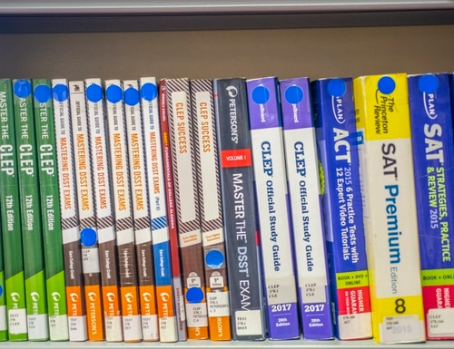 Test preparation books sit on the shelf at the base library at RAF Mildenhall, England, in October 2019. (Airman 1st Class Joseph Barron/Air Force)