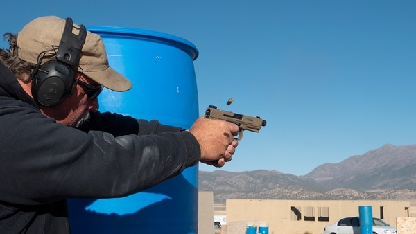 Some of the most popular (and accessible) shooting sports are pistol competitions. There's probably a club near you with shooters who welcome new competitors of any level. (Photo by David Bahde)