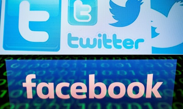 The logos for Twitter and Facebook are seen in this combination of file pictures. (AFP/Getty Images)