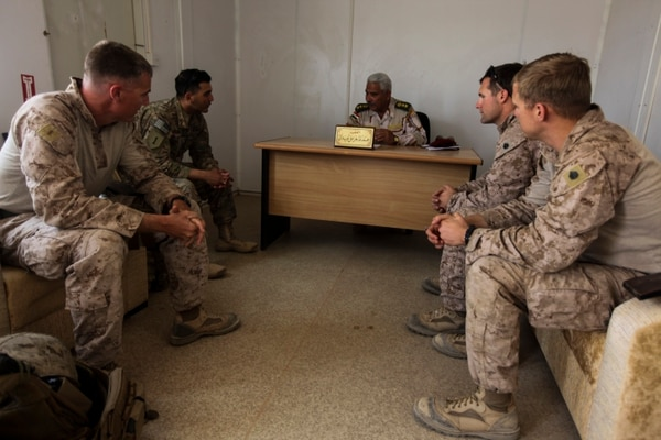 U.S. Marines with the explosive ordnance disposal team attached to Task Force Al Asad meet with an Iraqi colonel and his EOD team to discuss the status of their overall mission and to request permission to clear a cache of unexploded ordnance at Al Asad Air Base, Iraq, April 20, 2015. Task Force Al Asad is a coalition unit participating in Combined Joint Task Force – Operation Inherent Resolve's Building Partner Capacity mission, which trains and enables Iraqi Security Forces in their fight against the Islamic State of Iraq and the Levant by focusing on small unit leadership, medical procedures, air-ground integration, and equipping and sustainment processes. (U.S. Marine Corps Photo by Corporal Cansin P. Hardyegritag)