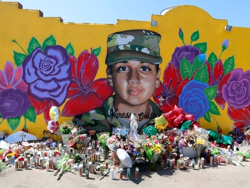 Offerings sit in front of a mural of slain Army Spc. Vanessa Guillen painted on a wall in the south side of Fort Worth, Texas, July 11. (LM Otero/AP)