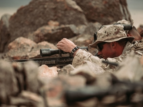 A U.S. Marine Corps scout sniper candidate with Weapons Company, 2nd Battalion, 7th Marine Regiment, 1st Marine Division, adjusts his sights during a live-fire exercise at Marine Corps Air Ground Combat Center, Twentynine Palms, California. (Pfc. Cedar Barnes/Marine Corps)