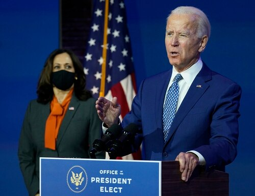 President-elect Joe Biden, joined by Vice President-elect Kamala Harris, speaks at The Queen theater, Monday, Nov. 9, 2020, in Wilmington, Del. (Carolyn Kaster/AP)