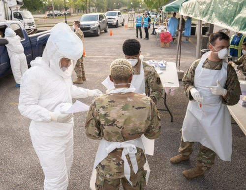 Louisiana National Guard Soldiers and Airmen test first responders for COVID-19 infections at Louis Armstrong Park, New Orleans, Louisiana, March 20, 2020. The testing site is one of three across New Orleans and Jefferson Parishes and will soon open to the general public. (U.S. Army National Guard photo by Staff Sgt. Josiah Pugh)