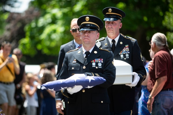 U.S. Army members carry a folded flag along with the remains of Vietnam War veteran Wayne Wilson during his memorial service at the Silverbrook Cemetery in Niles, Mich. on Wednesday, July 17, 2019. (Emil Lippe/Kalamazoo Gazette via AP)