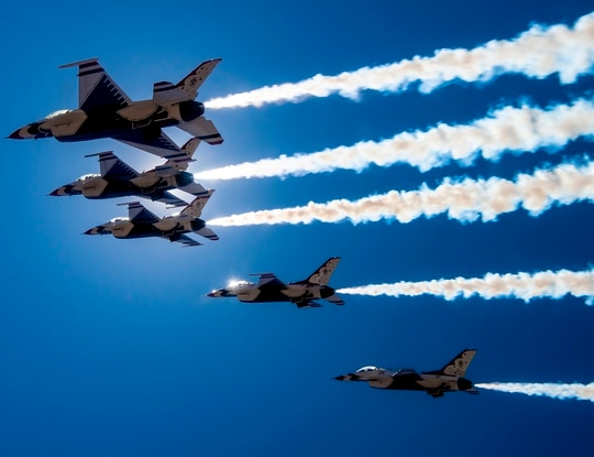 """The U.S Air Force Air Demonstration Squadron """"Thunderbirds"""" fly over Las Vegas on April 11, 2020, to show appreciation and support for the health-care workers, first responders and other essential personnel working on the front lines to combat COVID-19. (Staff Sgt. Cory W. Bush/Air Force)"""